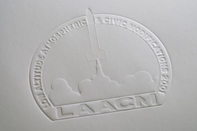 LAACM embossed mailer